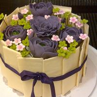A Chocolate Cake Decorated In Pure Chocolate Panels With Gumpaste Flowers A chocolate cake decorated in pure chocolate panels with gumpaste flowers!!