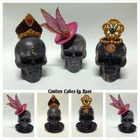 """undas"" A trio of skulls I made using candy melts and Wilton's plastic skull mold. Decors are made of gumpaste, fondant and modeling chocolate..."