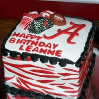 Alabama Football Cake cake is covered in buttercream with fondant accents