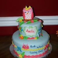 Owl Birthday Rice krispies in center of owl topper, (covered in fondant ). this was for my little grand niece turning one. Made her a little smash cake...