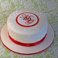 Ruby Anniversary Cream Cheese Pound Cake with Marzipan and MMF. All decorations are hand piped with Royal Icing.