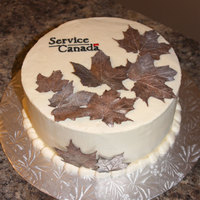 Fall In Canada  My husband works for the Canadian government and wanted a small cake for a new office opening. Since it was fall, I covered a buttercream...