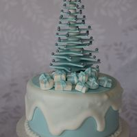 Fruit Cake Decorated In Fondant And Royal Icing The Tree And Presents Are Made From Fondant Fruit cake decorated in fondant and royal icing. The tree and presents are made from fondant.