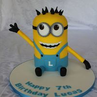 Minion Birthday Cake For A Friends Son The Mum Couldnt Bear To Stick A Knife In A Minion So This Is A Dummy Cake For Her To Keep  Minion birthday cake for a friend's son. The mum couldn't bear to stick a knife in a minion so this is a dummy cake for her to...