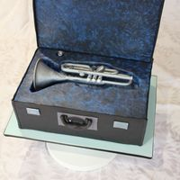 This Is A Trumpet Made Of Fondantgumpaste Mix Placed In A Cake Case It Was A Half Size Replica Of A Young Girls Own Trumpet It Fed An E  This is a trumpet made of fondant/gumpaste mix, placed in a cake case. It was a half size replica of a young girl's own trumpet. It...
