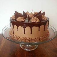 Chocolate Chocolate cake, filled and topped with chocolate ganache and frosted with chocolate IMBC.