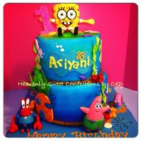 Sponge Bob Theme Birthday Cake Sponge Bob theme b-day cake.Bottom 10' chocolate cake w/ dark choco mousse filling. Top 8' Banana nut w/ banana cream filling....