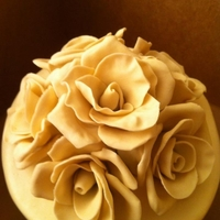 Ivory Gumpaste Roses these are roses i made for the top of a wedding cake i did. my first time to make them. used francesca tutorial.