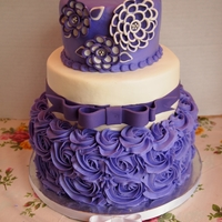 "Purple And White ""shawna Flower"" Birthday Cake 6,8,10 in round tiers.. Thanks to corriecakes for flower tutorial. The tiers are Italian cream, red velvet, and WASC. TFL!"