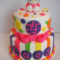 Hello Kitty Bling Cake 6,8 in tiers. White and chocolate cake. Lots of disco dust on bow, name, and number. TFL!!
