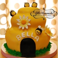 Beehive Cake With Cupcakes Beehive cake. Made with matching cupcakes. covered in fondant, all toppers, bees and flowers are edible. Marble cake.