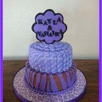 Simply Purple Cake A cake for 2 lovely ladies that love purple! Bottom tier was chocolate cake w/chocolate buttercream & top tier was french vanilla cake...