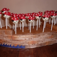 Pirate Pops   Cake pops - double dipped in white then red. Base made from florist foam, wrapped then covered in card.