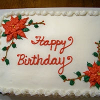 Christmas Themed Birthday Cake I made this for my mother whose birthday is Dec. 23rd. White cake with all buttercream.