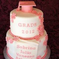 Graduation Cake cake covered in MMF, flowers and grad cap fondant