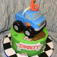 Monster Truck Base chocolate with buttercream. Truck white cake with fondant. Wheels are rice crispies.