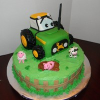 Green Tractor   Chocolate cake, fondant covered tractor, buttercream base, gumpaste animals.