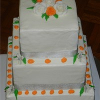 Simple Orange And Silver Butter cream cake.