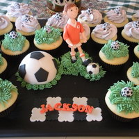 Soccer Birthday Cupcakes and small personal cake for the seven year old birthday boy.Gumpaste/Fondant Figure.