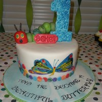 The Very Hungry Caterpillar Free-hand painted butterfly from Eric Carle's The Very Hungry Caterpillar atop this fondant covered cake. Caterpillar in fondant/...