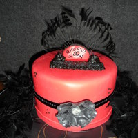 Red Fondant Studded Ribbon Feathers A Birthday Cake For My Fourteen Year Old Daughter Red Fondant, studded ribbon, feathers... a birthday cake for my fourteen year old daughter.