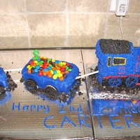 Thomas The Train This is a Thomas the train cake I did for my son's 2nd birthday. I used the Wilton 3D train pan and covered the cake with star tip...