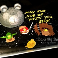 Angry Birds Star Wars Cake is covered in buttercream and airbrushed and textured. Hand cut fondant accents.
