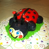 Lady Bug fondant covered yellow butter cake with buttercream icing. Made for a Church Picnic cake walk.