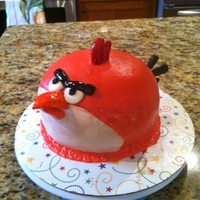 Angry Bird Cake mmf over yellow butter cake with fudge filling and chocolate buttercream. gumpaste beak and tail feathers.