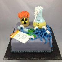 Monster Science Lab Cake   This cake is covered in fondant, with fondant and gum paste decorations.