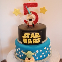 Star Wars Jedi Cake   Two tier covered in fondant. Modeling chocolate sculpted little boy figure and Yoda.