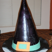 Witches Hat   Sculpted cake covered in buttercream and airbrushed. Brim on the hat is 50/50 fondant and gumpaste