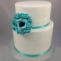 "Teal Flower Wedding Cake   Double 9"" first tier and a single 7"" second tier, covered in fondant with a gumpaste flower"