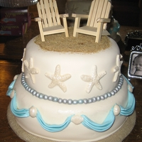 Beach Wedding   Two tier fondant covered with fondant swags and wood chairs. The shells are molded gum paste