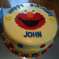 Elmo Cake Buttercream icing with MMF accents & bubble gum around bottom