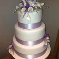 Lilac And White 3 Tier Wedding Cake i cant make flowers so i got a local lady to make these for me and i was over the moon with the result, simple yet elegant :)