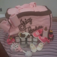 Juicy Couture Diaper Bag Vanilla Cake w/butter cream icing. Everything was made of fondant and are all editable. (Blocks, Babies,Shoes, Rattle, Bottle)