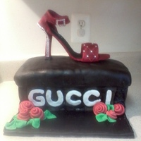Gucci Shoe Box  Red Shoe made of gum paste, rhinestones are not editable. Shoe Box cake, vanilla w/butter cream icing covered in fondant with fondant roses...