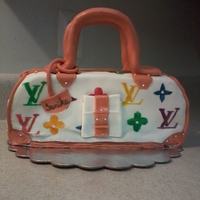 Louis Vuitton Cake Purse Lemon cake w/lemon butter cream incing fondant cake. Straps, and zipper are all fondant