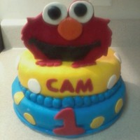 Elmo Birthday Cake Marble Cake w/chocolate butter cream icing. Decorations are all fondant.