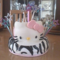 Hellow Kitty Birthday Cake Lemon cake w/lemon butter cream icing. All fondant decorations. Shooting stars are not editable.