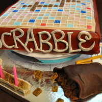 Scrabble Cake Scrabble Cake - Entire cake is edible. Game pieces made of gumpaste. Fondant covered yellow cake with chocolate mousse filling. Game board...