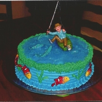 Fishing Birthday Cake chocolate and vanilla cake. Butter Cream frosting. I colored clear edible gel blue for the water..so easy and its a great effect.