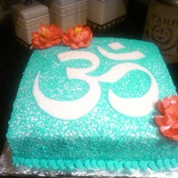 Om Symbol With Lotus Flowers Birthday Cake