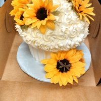 "Giant Sunflower Cupcake Red Velvet giant cupcake with a white chocolate ""wrapper"" and butter cream frosting. I used sunflowers and a tiny dragon fly as..."