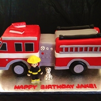 Fire Truck Cake Fire truck is all made of cake with fondant details.