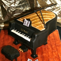 Grand Piano Cake Grand Piano cake. All edible except for legs, and lid (covered in fondant). Music and music stand made of gumpaste.