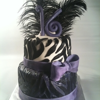 Sweet 16 Purple Zebra With Feathers! Sweet 16 cake with zebra, zebra and more zebra! With a fondant/gumpaste bow, lots of glitter-and feathers.