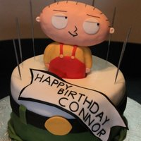 "This Birthday Cake Represents The Character Stewie From The Cartoon The Family Guy It Was Made For A Friends Sons Birthday The Cake This birthday cake represents the character ""Stewie"" from the cartoon ""The Family Guy"" It was made for a friend's..."