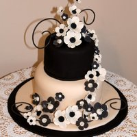 Ebony & Ivory Wedding Cake This was for a friend's wedding, just a small affair. Gumpaste flowers and swirls. Top layer was a delicious chocolate cake recipe I...
